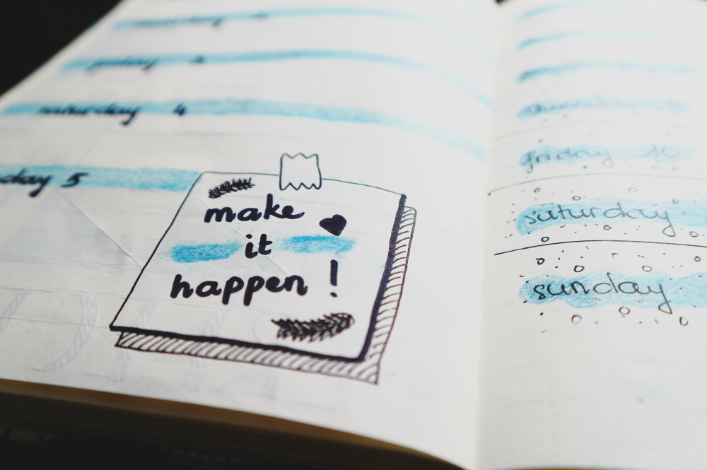 journal with make it happen on it how to overcome anxiety and procrastination