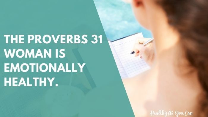 woman sitting by pool writing in journal